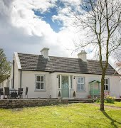 This modern Sligo farmhouse with a dreamy home office chalet and a treehouse is for sale for €245,000